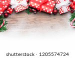 christmas gifts on wooden...   Shutterstock . vector #1205574724