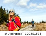 Man And Woman Hikers Hiking On...