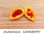 ripe fruit of momordica... | Shutterstock . vector #1205685997