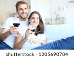 young loving couple drinking a... | Shutterstock . vector #1205690704