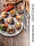 canapes with cream cheese and... | Shutterstock . vector #1205712631