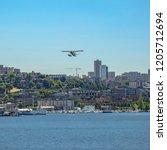 float plane over seaport city... | Shutterstock . vector #1205712694