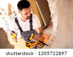 tearing down the concrete wall... | Shutterstock . vector #1205722897