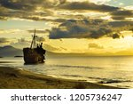 an old abandoned shipwreck ... | Shutterstock . vector #1205736247