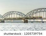 railway bridge in riga over the ... | Shutterstock . vector #1205739754