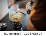 photo of drip coffee  drop...   Shutterstock . vector #1205765524