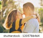 couple kissing in park in... | Shutterstock . vector #1205786464
