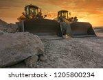 Two Excavators Removing Stone...