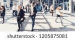 crowd of people walking street | Shutterstock . vector #1205875081