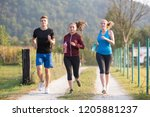 group of young people jogging... | Shutterstock . vector #1205881237
