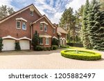 cobbled circle driveway with... | Shutterstock . vector #1205882497
