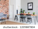 black chairs at dining table... | Shutterstock . vector #1205887804
