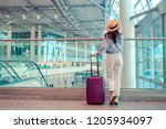 young woman in hat with baggage ... | Shutterstock . vector #1205934097