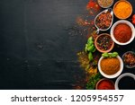 spices and herbs on a wooden... | Shutterstock . vector #1205954557