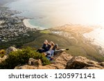 a couple is relaxing on top of... | Shutterstock . vector #1205971141