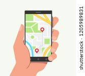 hand holding phone with map and ... | Shutterstock . vector #1205989831