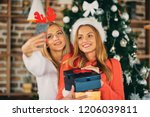 girlfriends taking selfie and... | Shutterstock . vector #1206039811