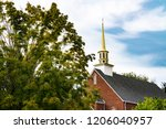 Church Steeple With Tree In...
