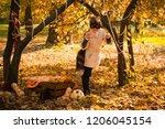 girl in halloween holiday is... | Shutterstock . vector #1206045154