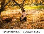 girl in halloween holiday is... | Shutterstock . vector #1206045157