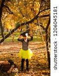 girl in halloween holiday is... | Shutterstock . vector #1206045181