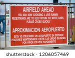 Gibraltar, United Kingdom, 3rd October 2018:- A warning sign as the public highway crosses the runway at Gibraltar. Gibraltar is a British Overseas Territory located on the southern tip of Spain. - stock photo