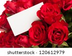 Stock photo red roses with a blank gift tag 120612979