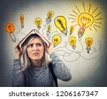perplexed young woman holding a ... | Shutterstock . vector #1206167347