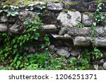 ancient wall of gray stones... | Shutterstock . vector #1206251371