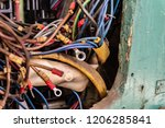 old multicolored wires in the... | Shutterstock . vector #1206285841