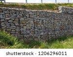 a fragment of a retaining wall... | Shutterstock . vector #1206296011