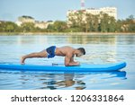 handsome sporty man doing plank ... | Shutterstock . vector #1206331864