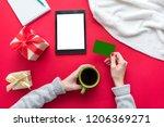 female hands  woman holding a...   Shutterstock . vector #1206369271