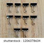 row of folding cluips on wooden ...   Shutterstock . vector #1206378634