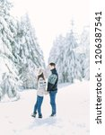 happy loving couple walking in... | Shutterstock . vector #1206387541