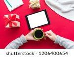 female hands  woman holding a...   Shutterstock . vector #1206400654