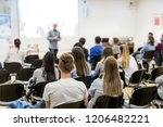 speaker lecturing in lecture... | Shutterstock . vector #1206482221