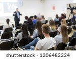 speaker lecturing in lecture... | Shutterstock . vector #1206482224