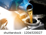 refueling and pouring oil... | Shutterstock . vector #1206520027