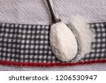 closeup of a spoon with refined ... | Shutterstock . vector #1206530947