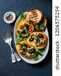 baked bell peppers stuffed... | Shutterstock . vector #1206575254