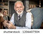 good day. senior business man.... | Shutterstock . vector #1206607504