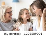 smiling mother  daughter and... | Shutterstock . vector #1206609001