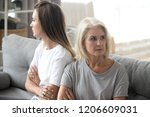offended elderly mother and... | Shutterstock . vector #1206609031
