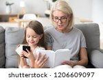 grandmother read book to little ...   Shutterstock . vector #1206609097