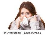 sick freezing woman sneezing in ...   Shutterstock . vector #1206609661