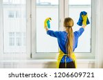 young woman in yellow gloves... | Shutterstock . vector #1206609721