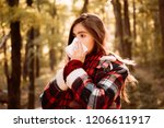 young woman with nose wiper... | Shutterstock . vector #1206611917