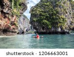 woman paddling the sea kayak in ... | Shutterstock . vector #1206663001