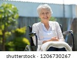 happy senior woman sitting on...   Shutterstock . vector #1206730267